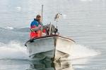 Ein Inuit kommt vom Fischfang
