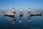 Fischer mit traditionellen Reusen auf dem Inle See